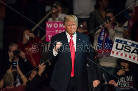 stock-photo-hershey-pa-december-president-elect-donald-trump-gives-a-fist-pump-to-the-crowd-as-551329747