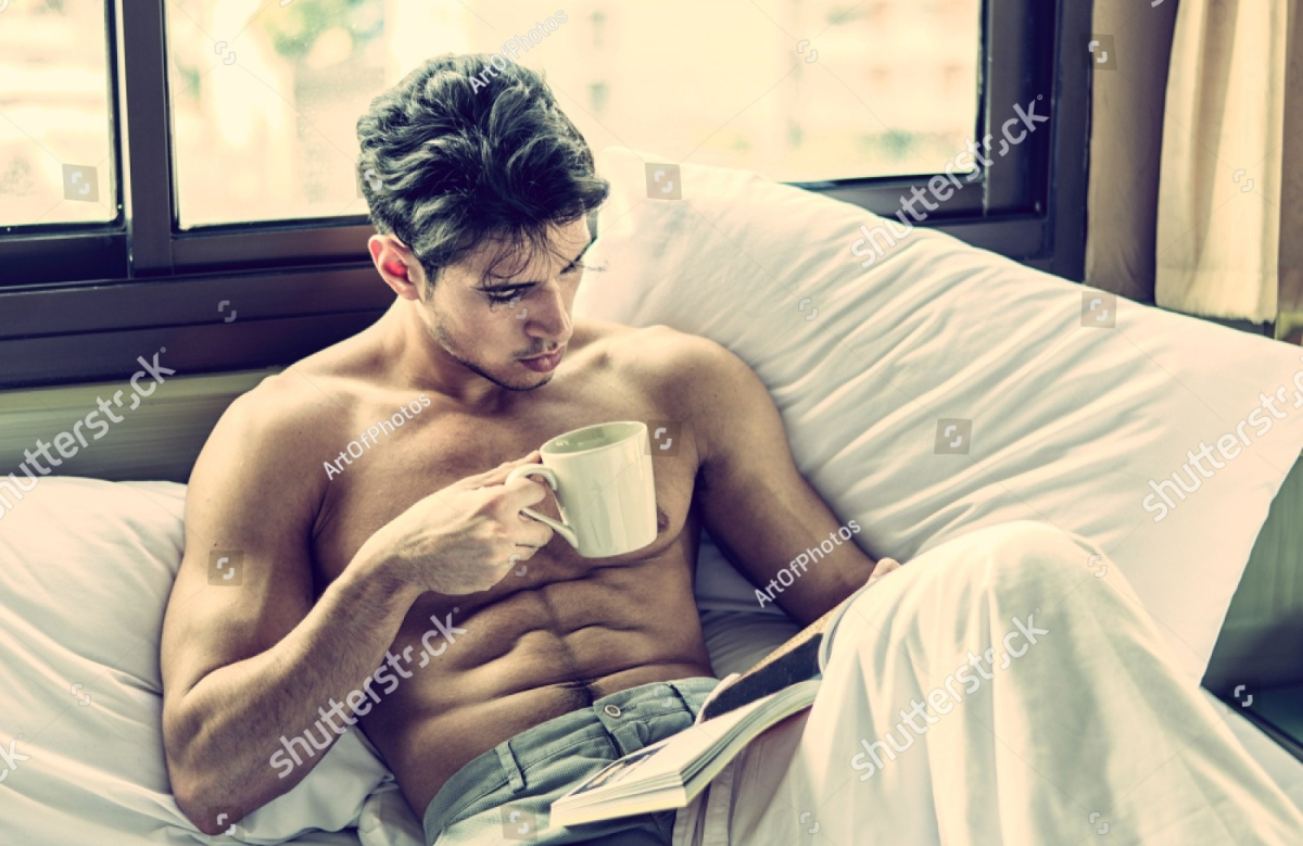 stock-photo-sexy-handsome-young-man-laying-shirtless-on-his-bed-next-to-window-holding-a-coffee-or-tea-cup-1012963357.jpg
